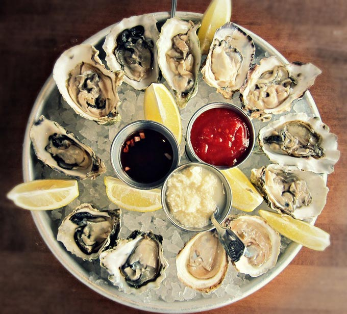 dozen oysters on the half shell platter
